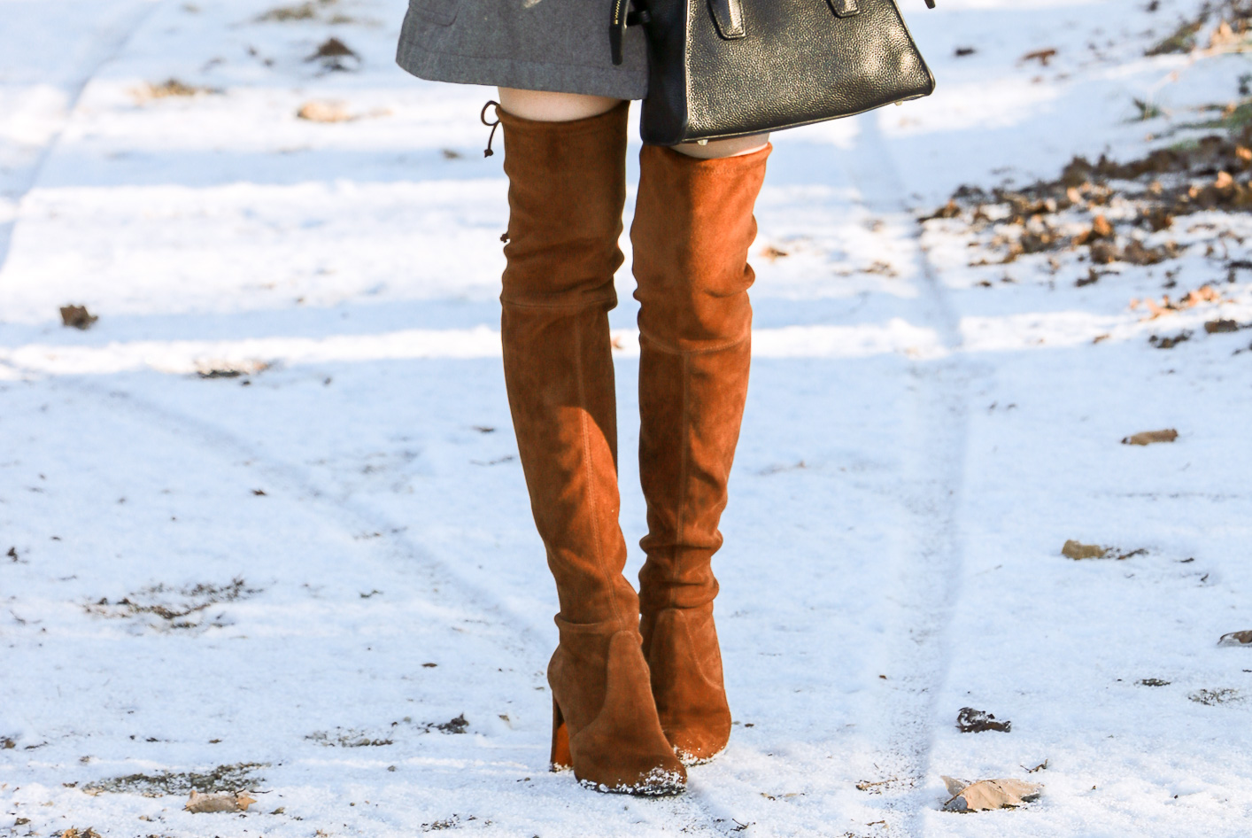 Fashion blogger Veronika Lipar of Brunette From Wall Street sharing 5 Ways to Style and Wear the Over the Knee Boots this winter