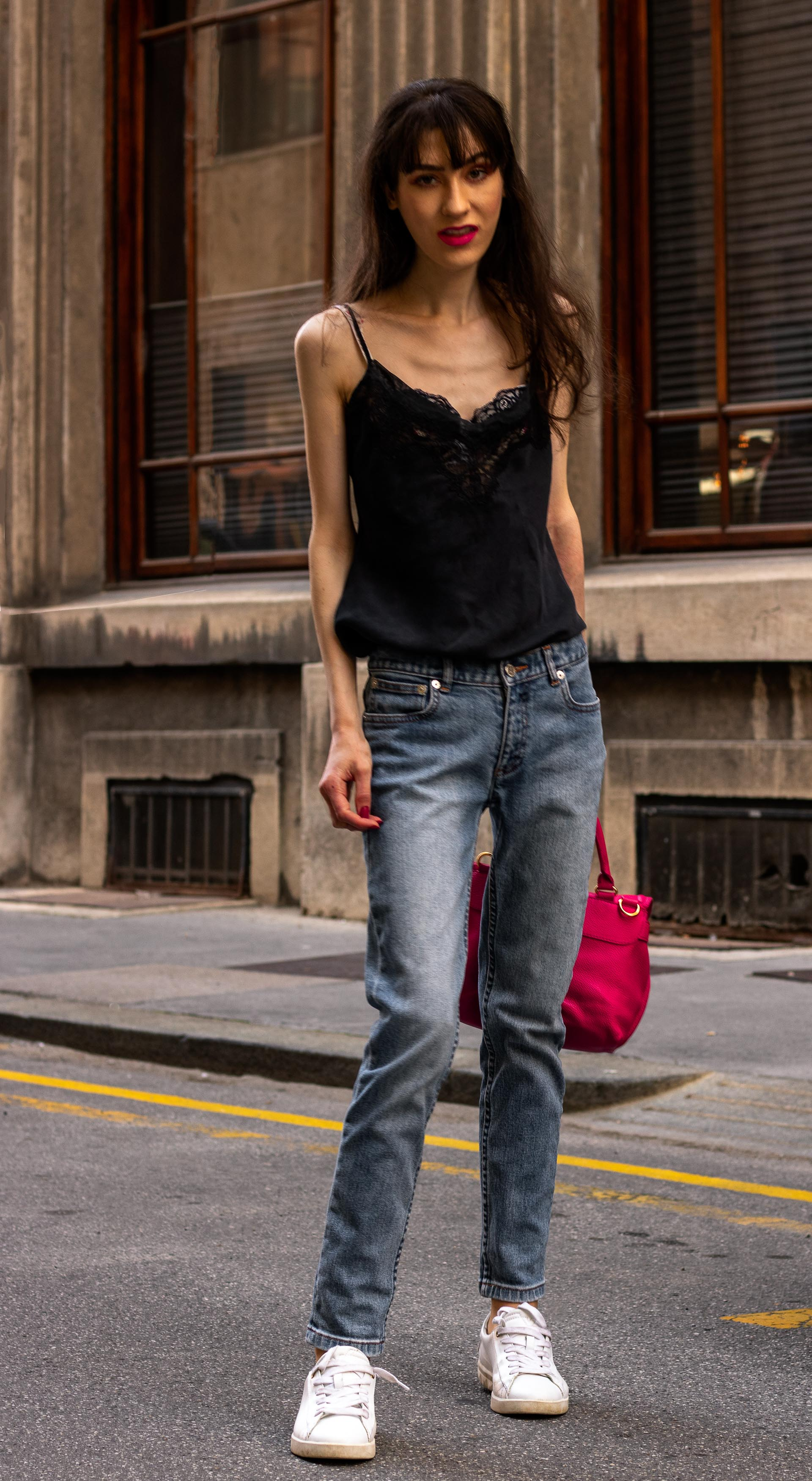 Must follow Fashion Blogger Veronika Lipar of Brunette from Wall Street dressed in A.P.C. Paris blue denim jeans Diesel white low sneakers Aubade black cami pink top handle bag on the street in summer