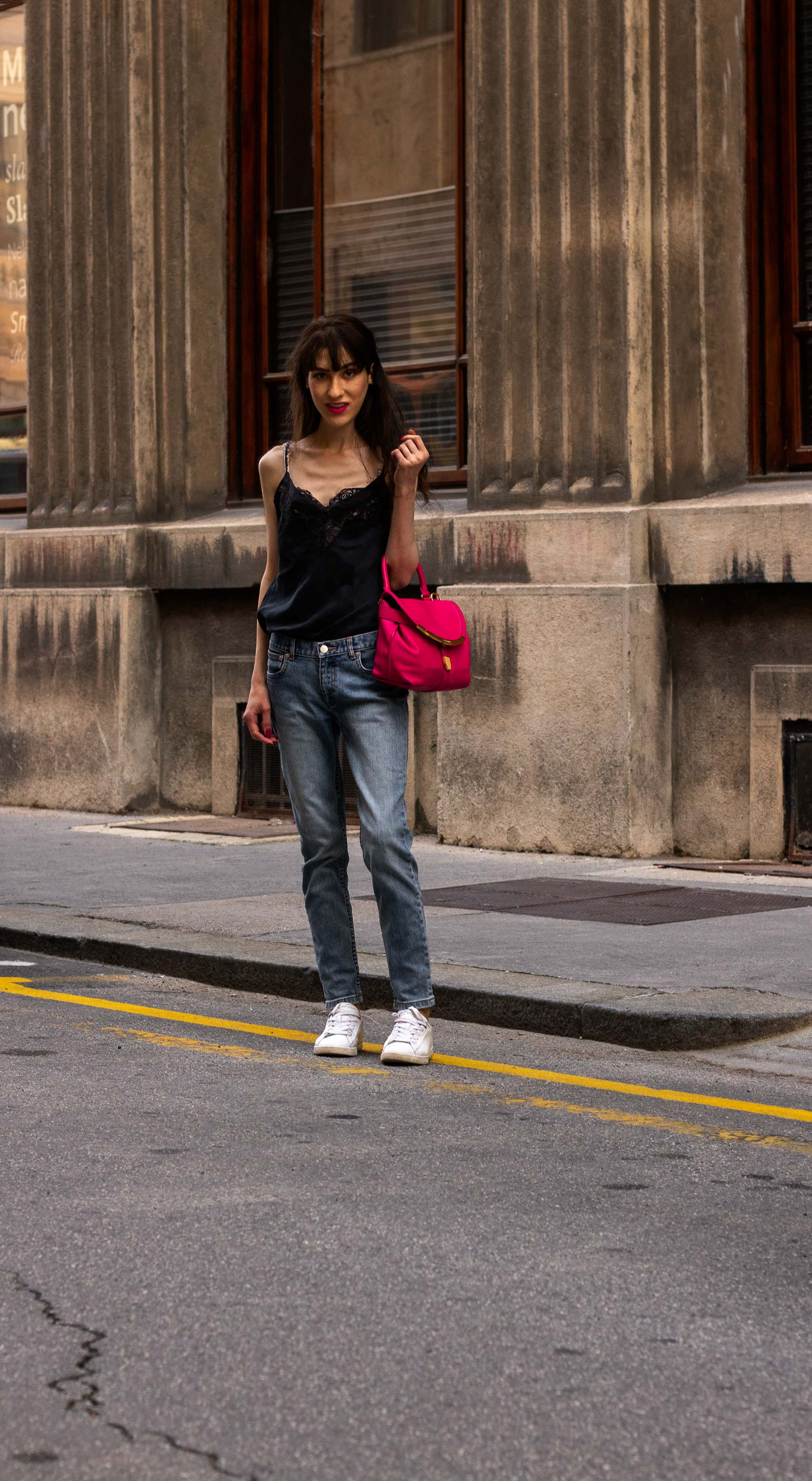 Must follow Fashion Blogger Veronika Lipar of Brunette from Wall Street dressed in A.P.C. Paris blue denim jeans Diesel white low sneakers Aubade black slip top pink top handle bag on the street in summer