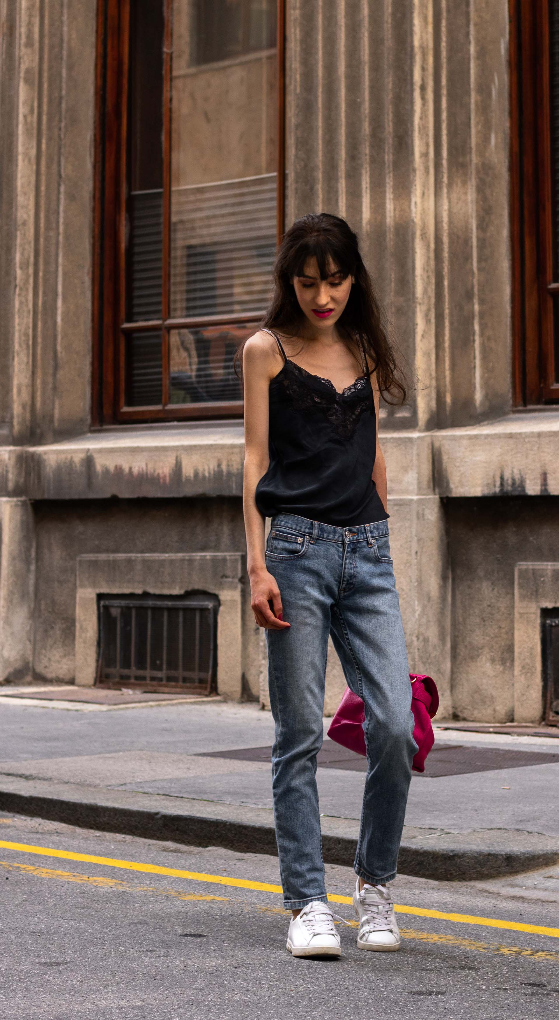 Must follow Fashion Blogger Veronika Lipar of Brunette from Wall Street wearing A.P.C. Paris blue denim jeans Diesel white low sneakers Aubade black cami pink top handle bag on the street in summer