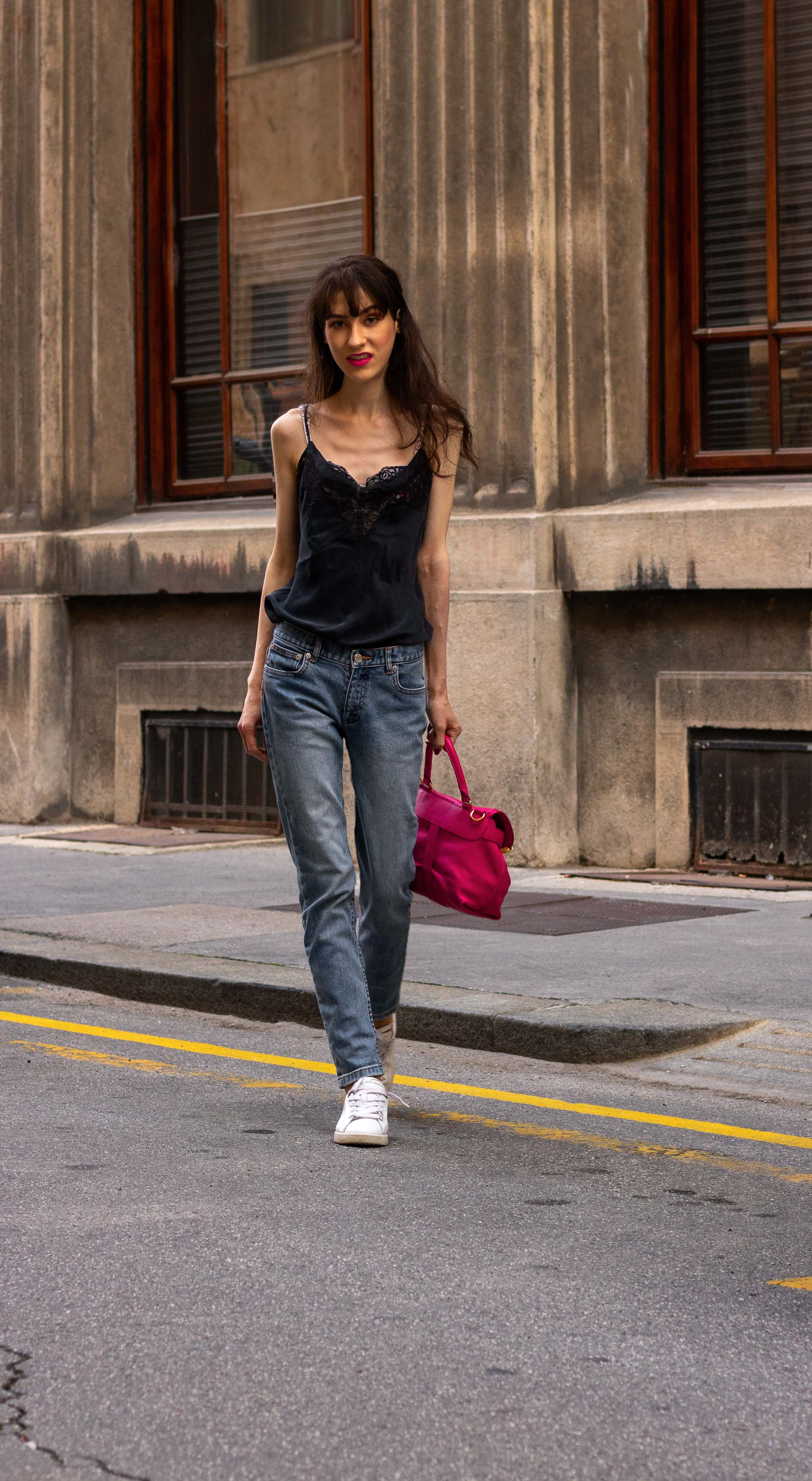Must follow Fashion Blogger Veronika Lipar of Brunette from Wall Street wearing A.P.C. Paris blue denim jeans Diesel white low sneakers Aubade black slip top pink top handle bag on the street in summer
