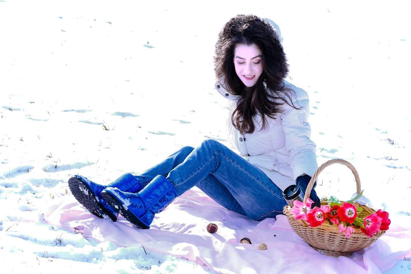 Fashion blogger Veronika Lipar of Brunette From Wall Street sharing how to wear the puffer jacket and UGG boots this winter for a picnic in the snow