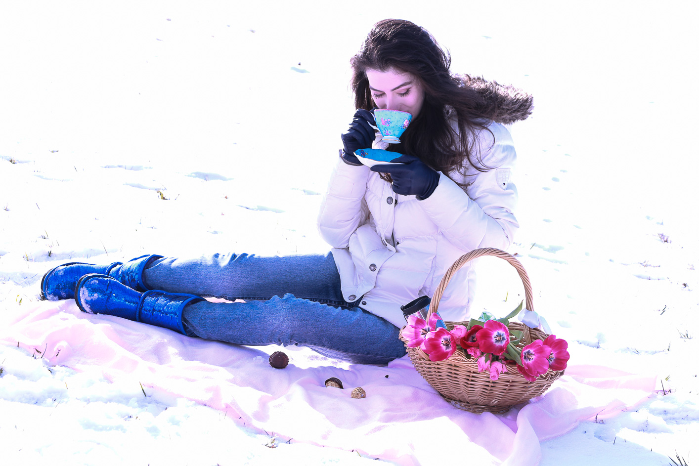 Fashion blogger Veronika Lipar of Brunette From Wall Street sharing how to style the puffer jacket and UGG boots for a winter picnic in the snow