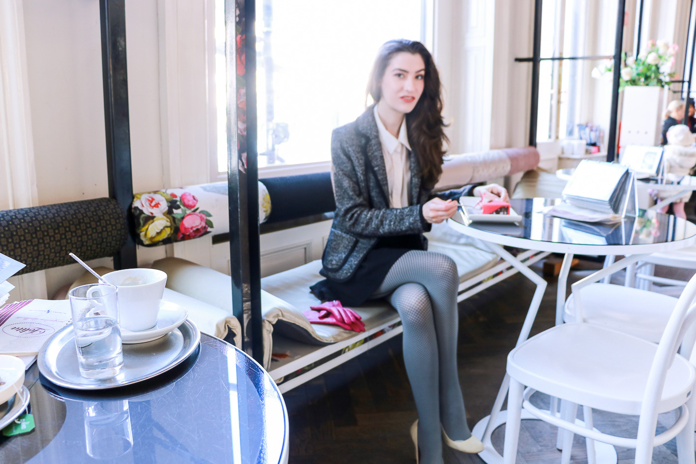 Fashion blogger Veronika Lipar of Brunette From Wall Street sharing how to wear the fishnets this winter