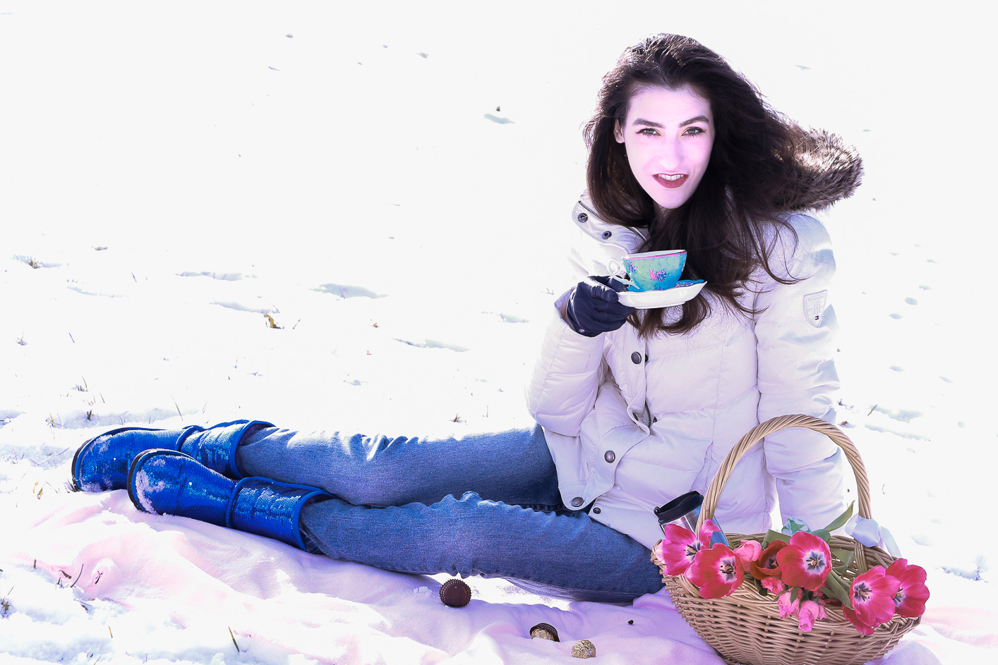 Fashion blogger Veronika Lipar of Brunette From Wall Street sharing how to wear the puffer jacket and UGG boots for a winter picnic in the snow