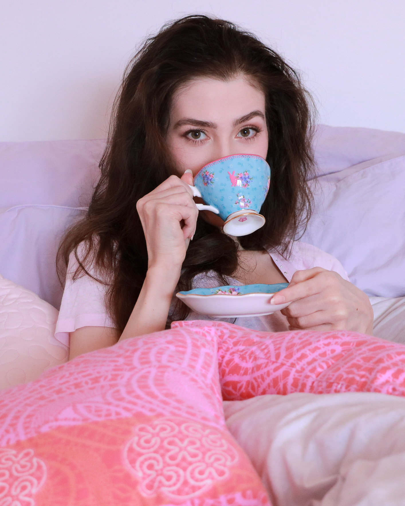 Fashion blogger Veronika Lipar of Brunette From Wall Street having coffee in her bed