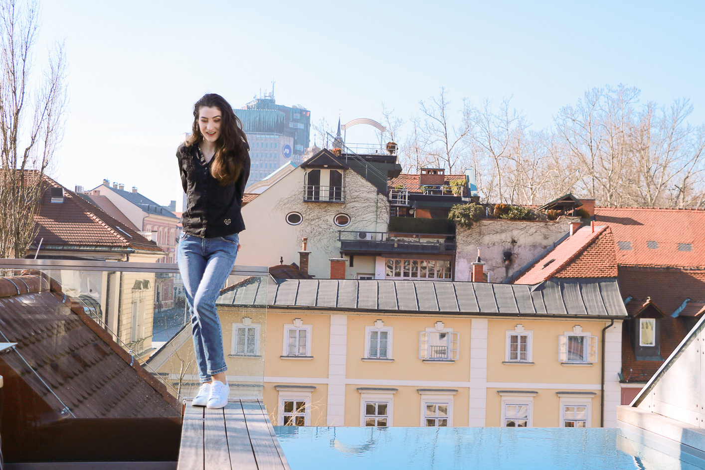 Fashion blogger Veronika Lipar of Brunette From Wall Street sharing how to style mom jeans