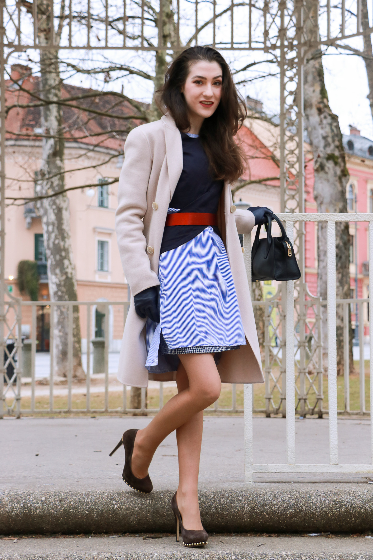 Fashion Blogger Veronika Lipar of Brunette from Wall Street sharing how to style the striped shirt dress