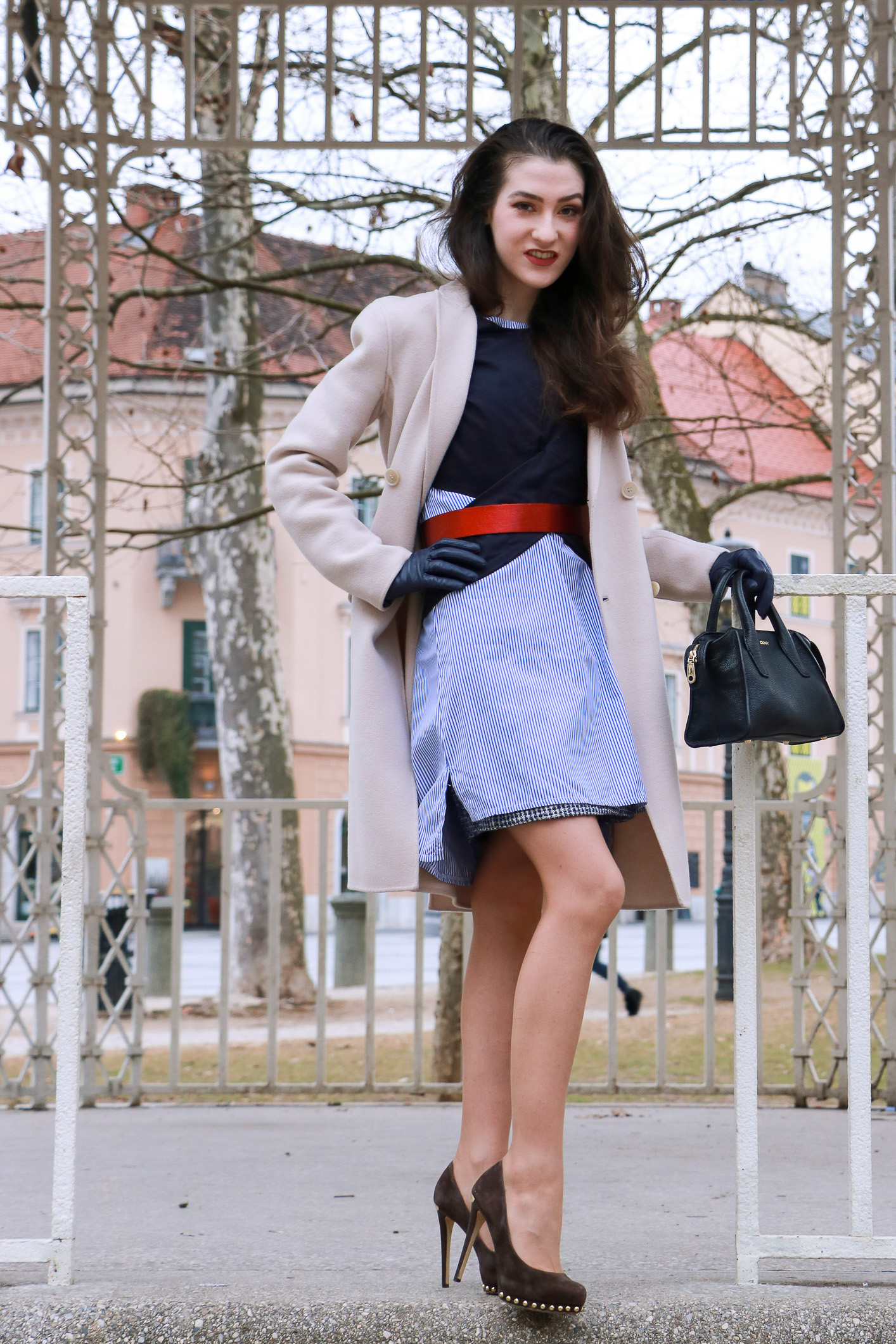 Fashion Blogger Veronika Lipar of Brunette from Wall Street sharing how to wear the striped shirt dress