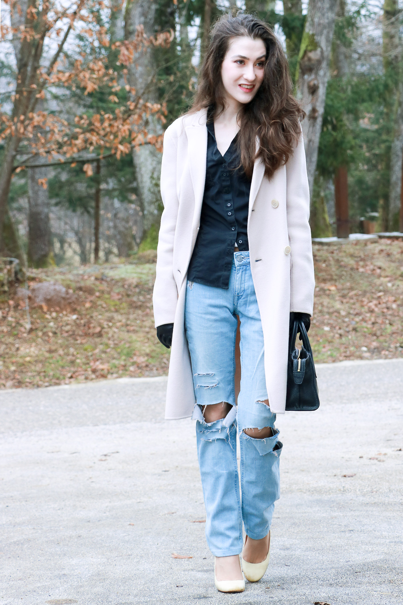 Fashion blogger Veronika Lipar of Brunette From Wall Street sharing how to style blue ripped jeans for a chic Friday Look