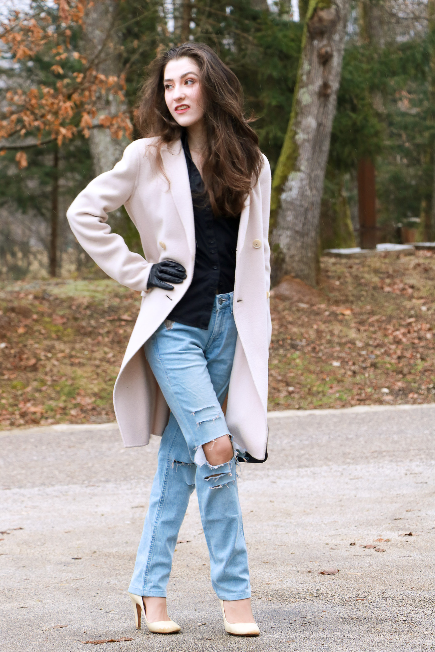Fashion blogger Veronika Lipar of Brunette From Wall Street sharing how to wear blue ripped jeans for a chic Friday Style