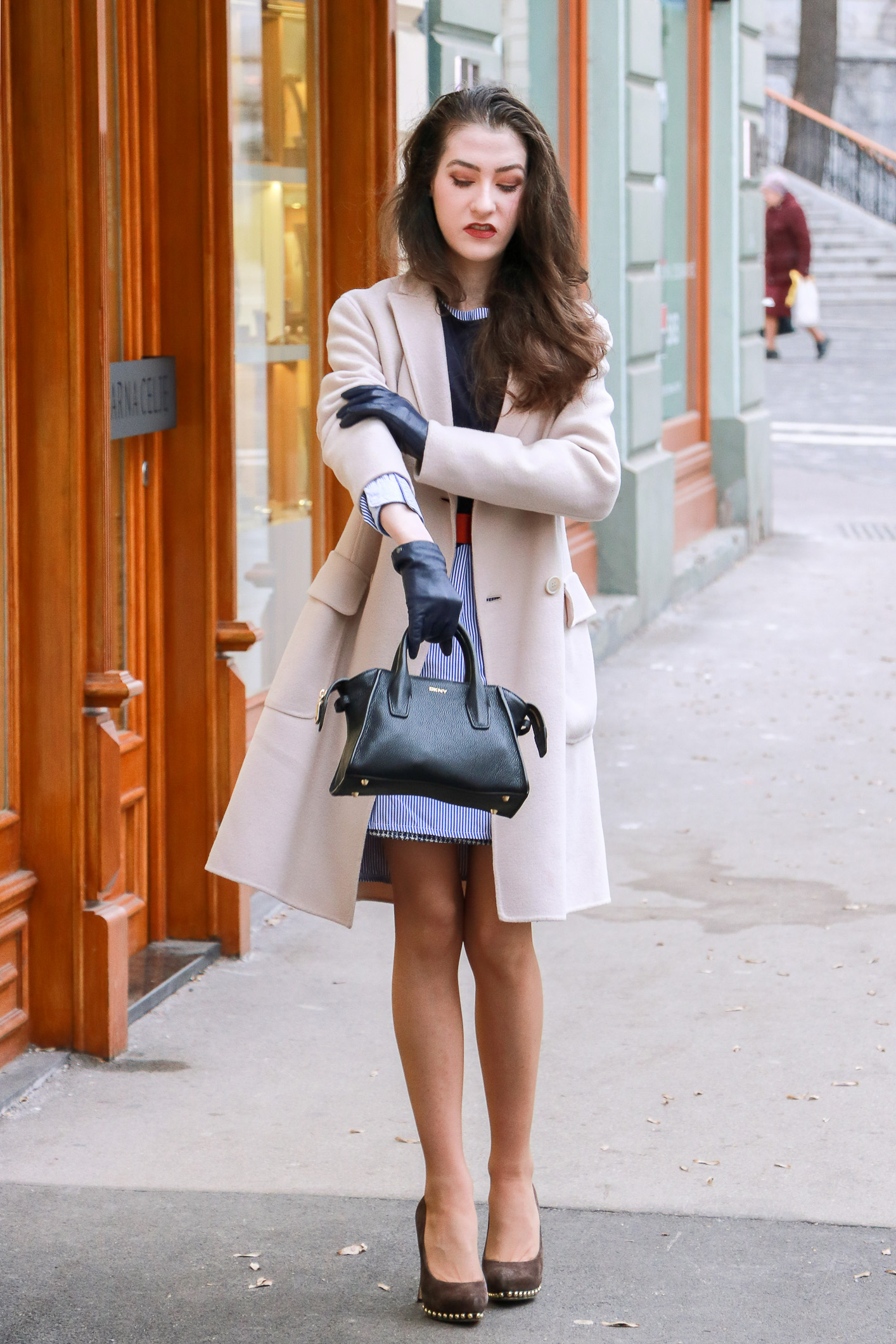 Fashion Blogger Veronika Lipar of Brunette from Wall Street sharing how to wear his shirt and wear it as a shirt dress