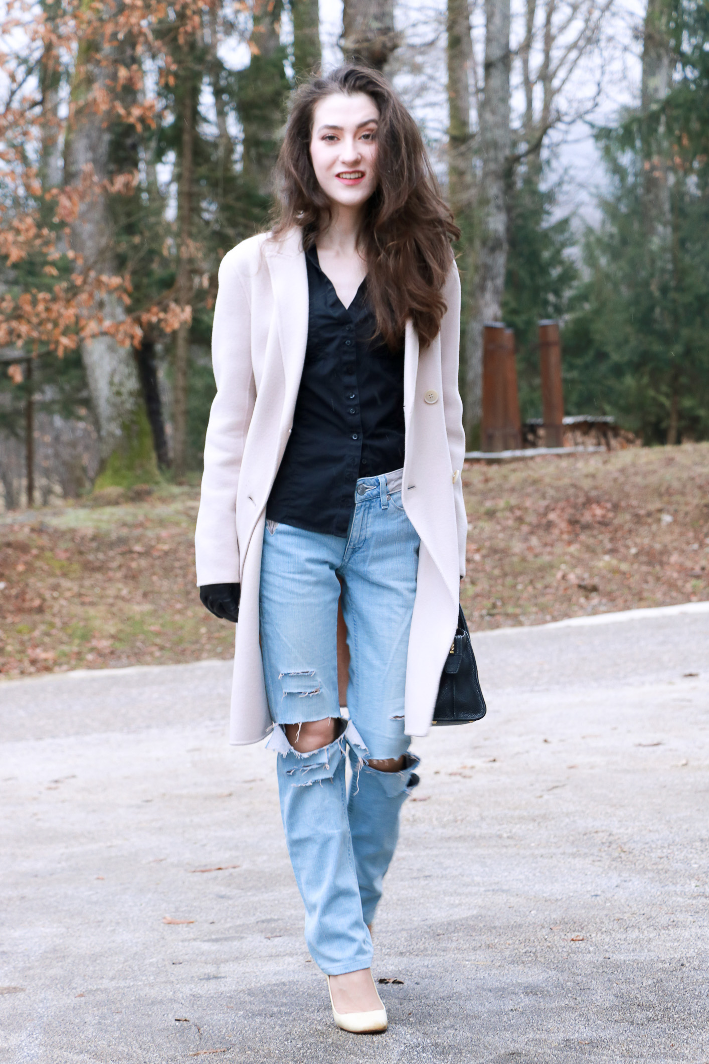 Fashion blogger Veronika Lipar of Brunette From Wall Street sharing how to style blue ripped jeans for a chic Friday Outfit
