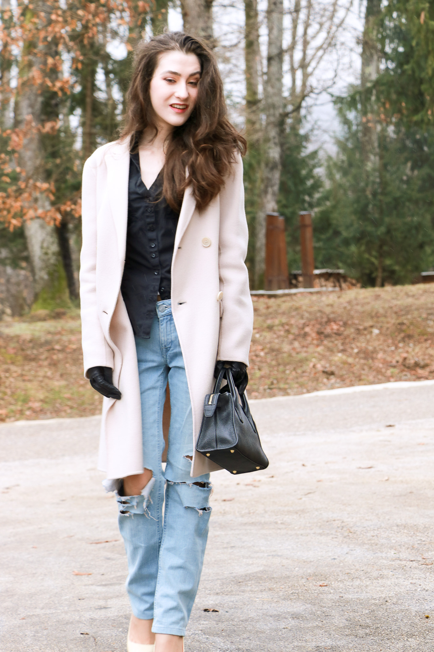 Fashion blogger Veronika Lipar of Brunette From Wall Street sharing how to DIY the blue ripped jeans for a chic Casual Friday Look
