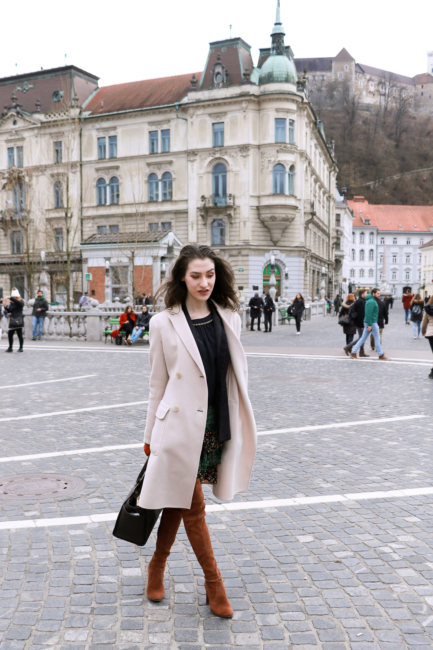 Fashion blogger Veronika Lipar of Brunette From Wall Street sharing how to style bohemian skirt