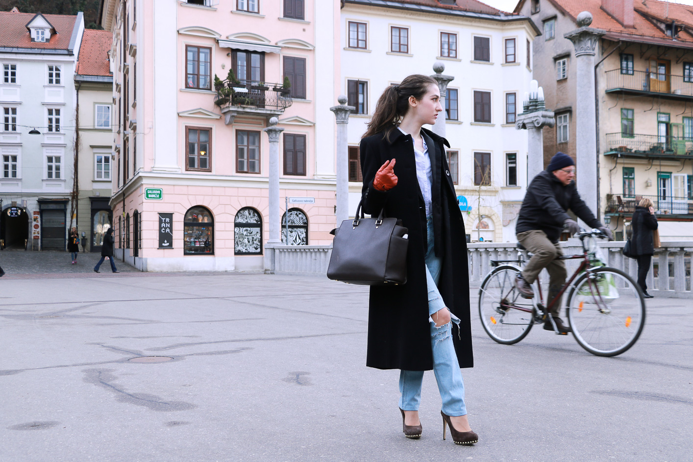 Fashion blogger Veronika Lipar of Brunette From Wall Street sharing how to style blue ripped jeans for a chic Casual Look