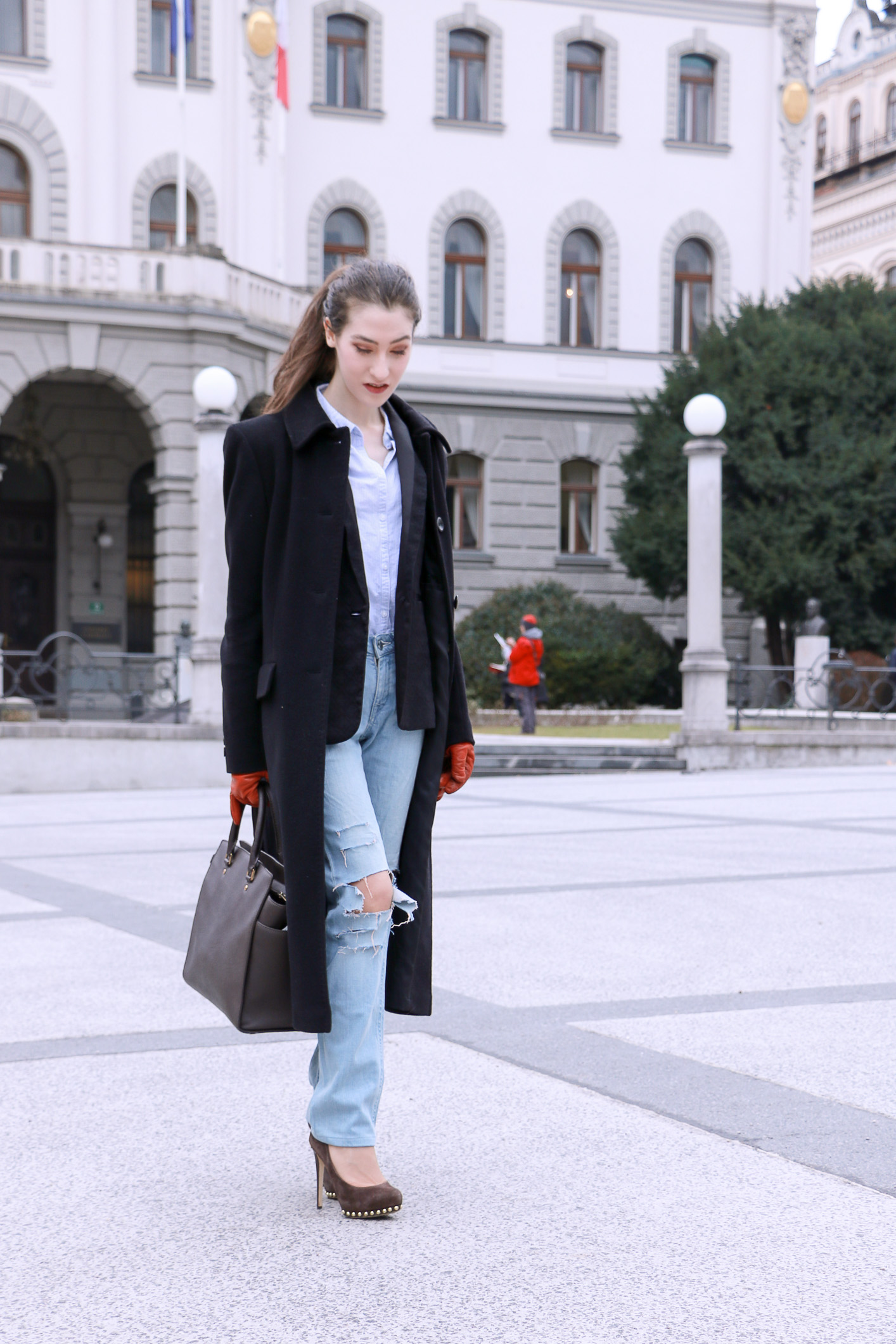 Fashion blogger Veronika Lipar of Brunette From Wall Street sharing how to DIY the blue ripped jeans for a chic Casual Look