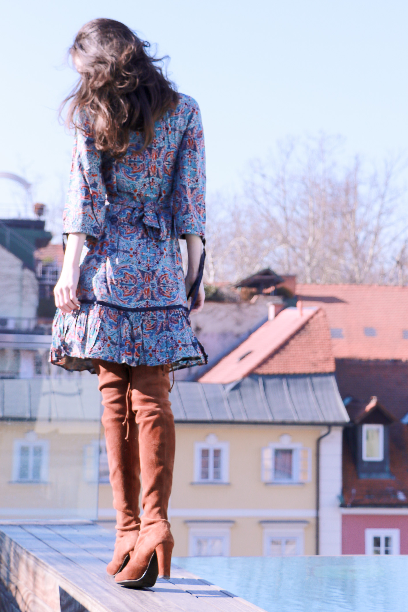 Fashion blogger Veronika Lipar of Brunette From Wall Street sharing how to wear bohemian dress in the city