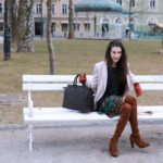 Fashion blogger Veronika Lipar of Brunette From Wall Street sharing how to style a ruffled skirt and the over the knee boots