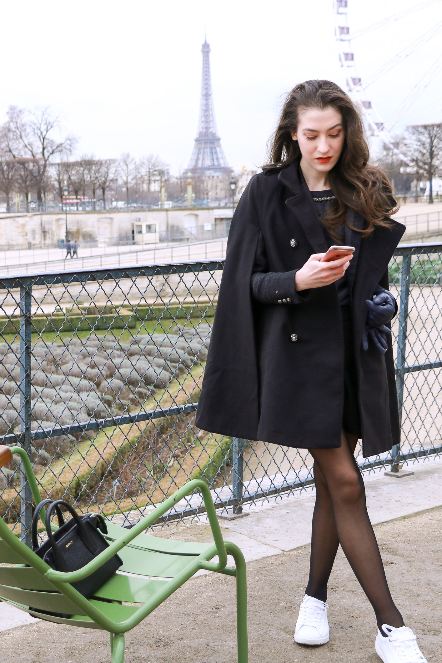 Fashion Blogger Veronika Lipar of Brunette from Wall Street sharing how to style chic black ruffled mini skirt, sexy black tights and white sneakers like a chic Parisian fashionista