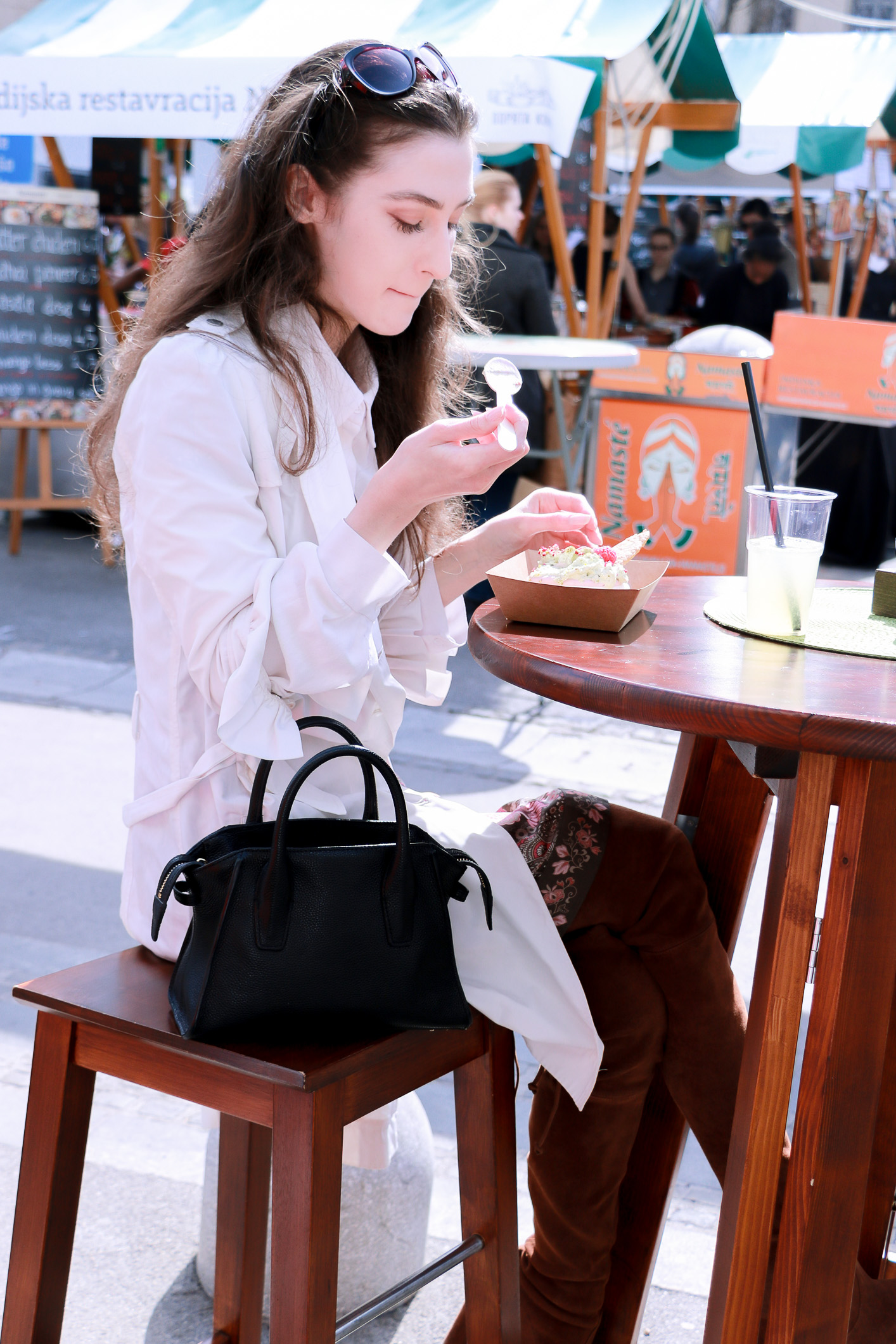 Fashion blogger Veronika Lipar of Brunette From Wall Street enjoying delicious food at the Open Kitchen Odprta Kuhna in her Short Fashion Story