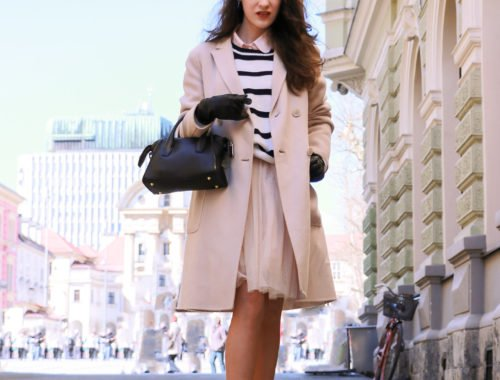 Fashion blogger Veronika Lipar of Brunette From Wall Street standing on the edge of Castle Hill as a princess escaping from Ljubljana castle in a Fashion Story about tulle dress and striped sweater
