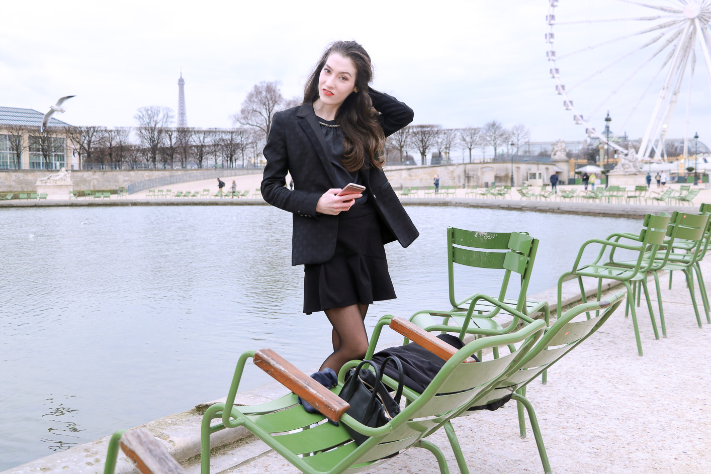 Fashion Blogger Veronika Lipar of Brunette from Wall Street sharing how to wear chic black ruffled mini skirt, sexy black tights and white sneakers like a chic Parisian fashionista