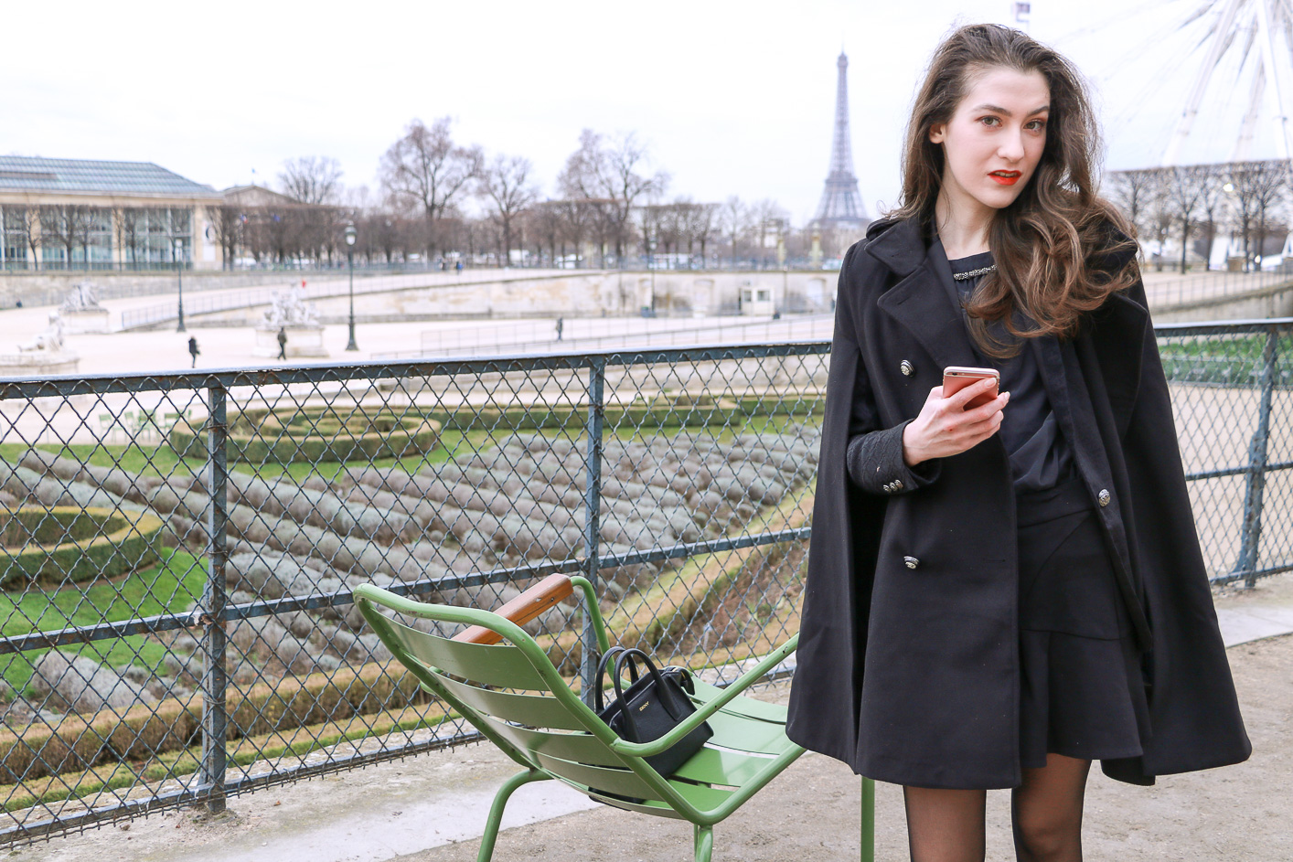 Fashion Blogger Veronika Lipar of Brunette from Wall Street sharing how to wear chic black ruffled mini skirt, sexy black tights and white sneakers as a Parisian