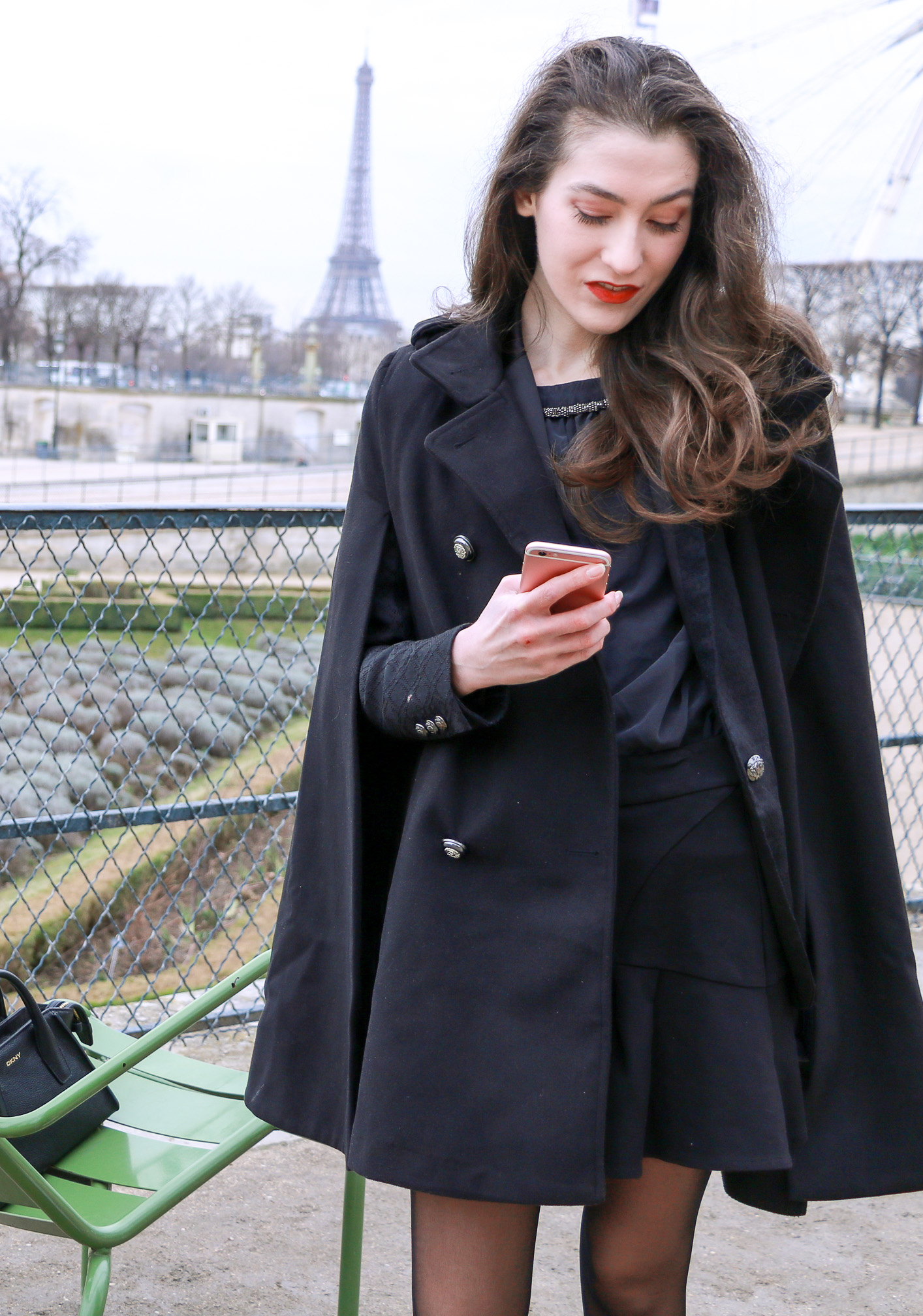 Fashion Blogger Veronika Lipar of Brunette from Wall Street sharing how to style chic black ruffled mini skirt, sexy black tights and white sneakers like a French