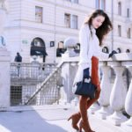 Fashion blogger Veronika Lipar of Brunette From Wall Street sharing how to wear a long thin trench coat this spring
