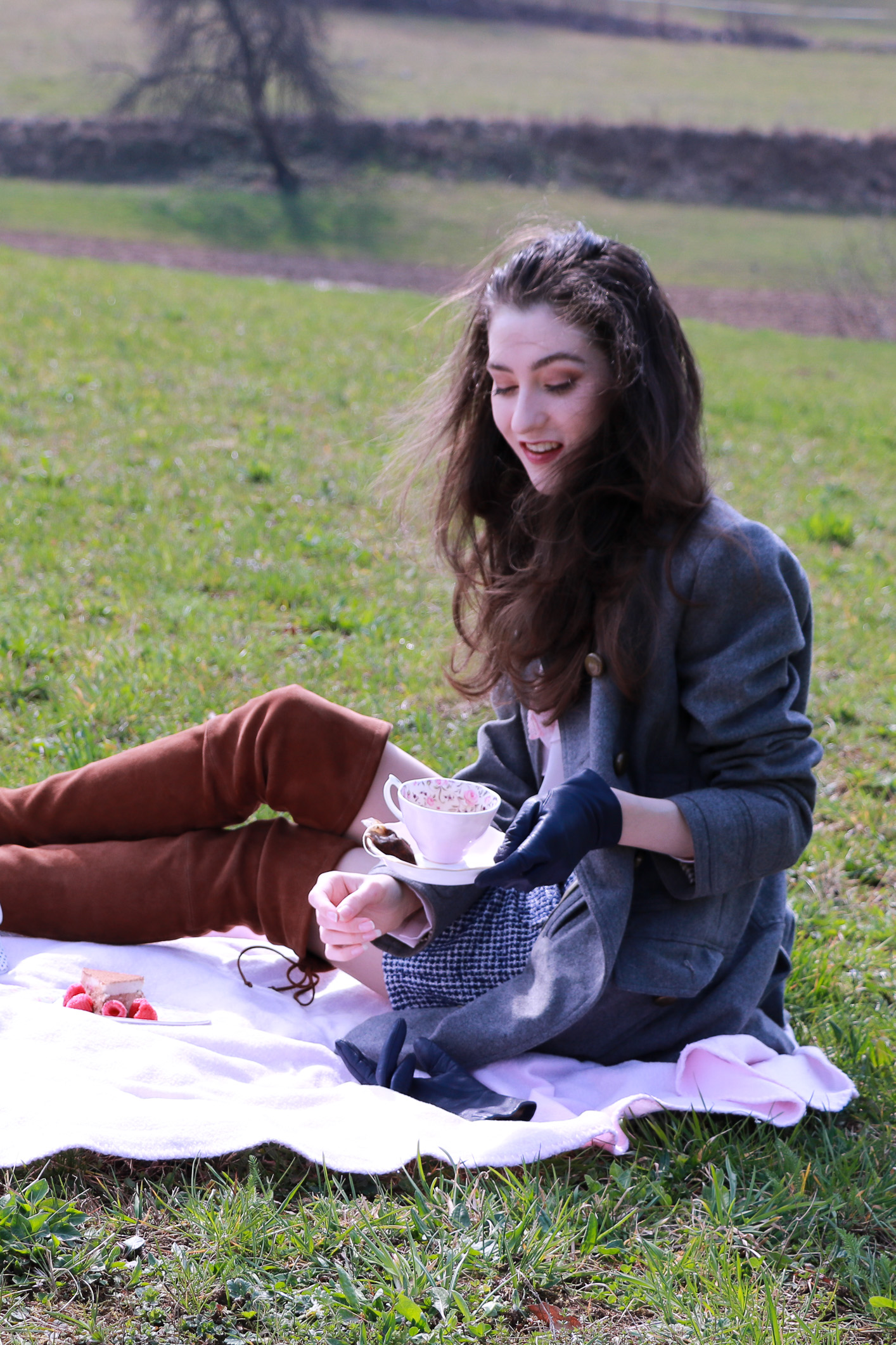 Fashion blogger Veronika Lipar of Brunette From Wall Street having a cup of tea at the first spring picnic