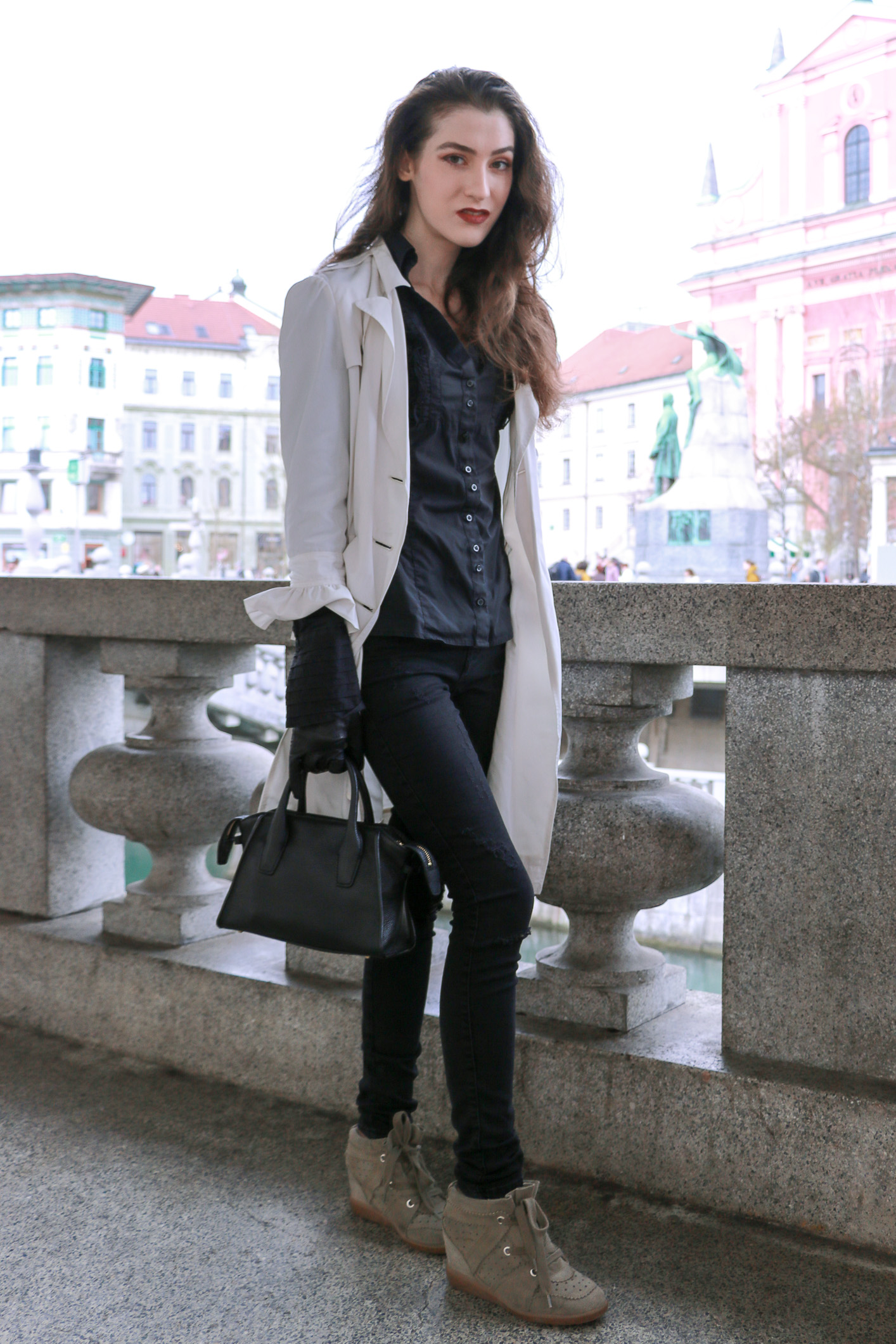 Fashion blogger Veronika Lipar of Brunette From Wall Street sharing how to style ruffled sleeves to look chic not girly