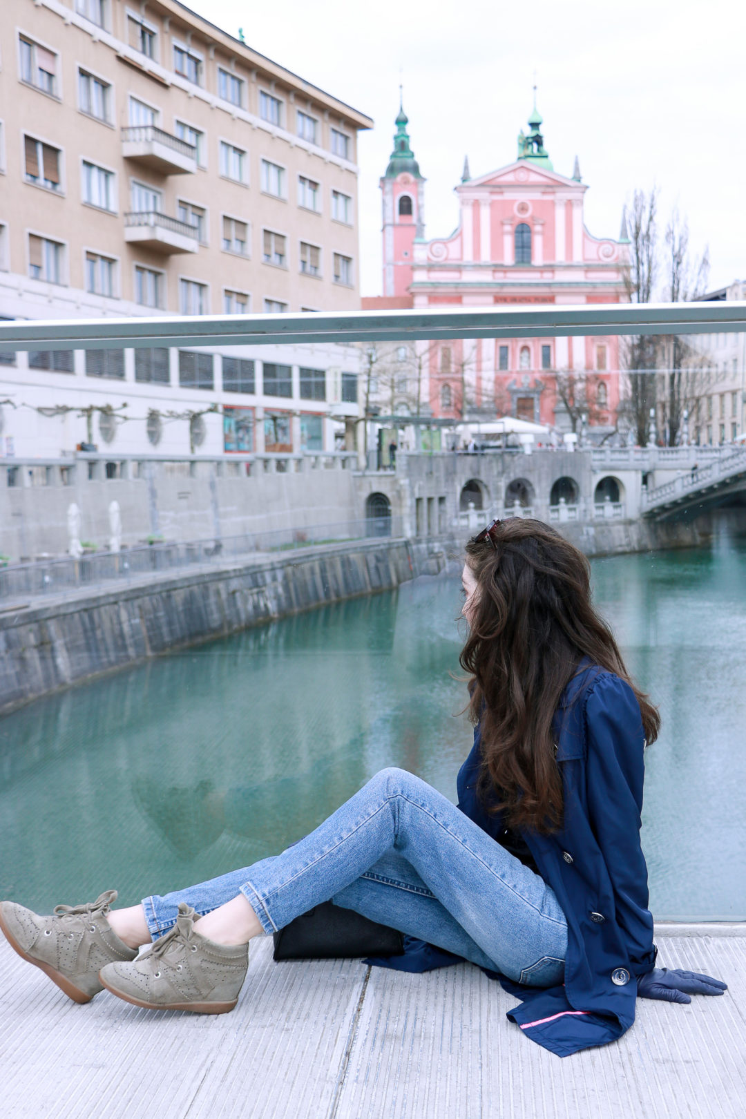 Fashion blogger Veronika Lipar of Brunette From Wall Street sharing her chic casual Friday outfit in shades of blue