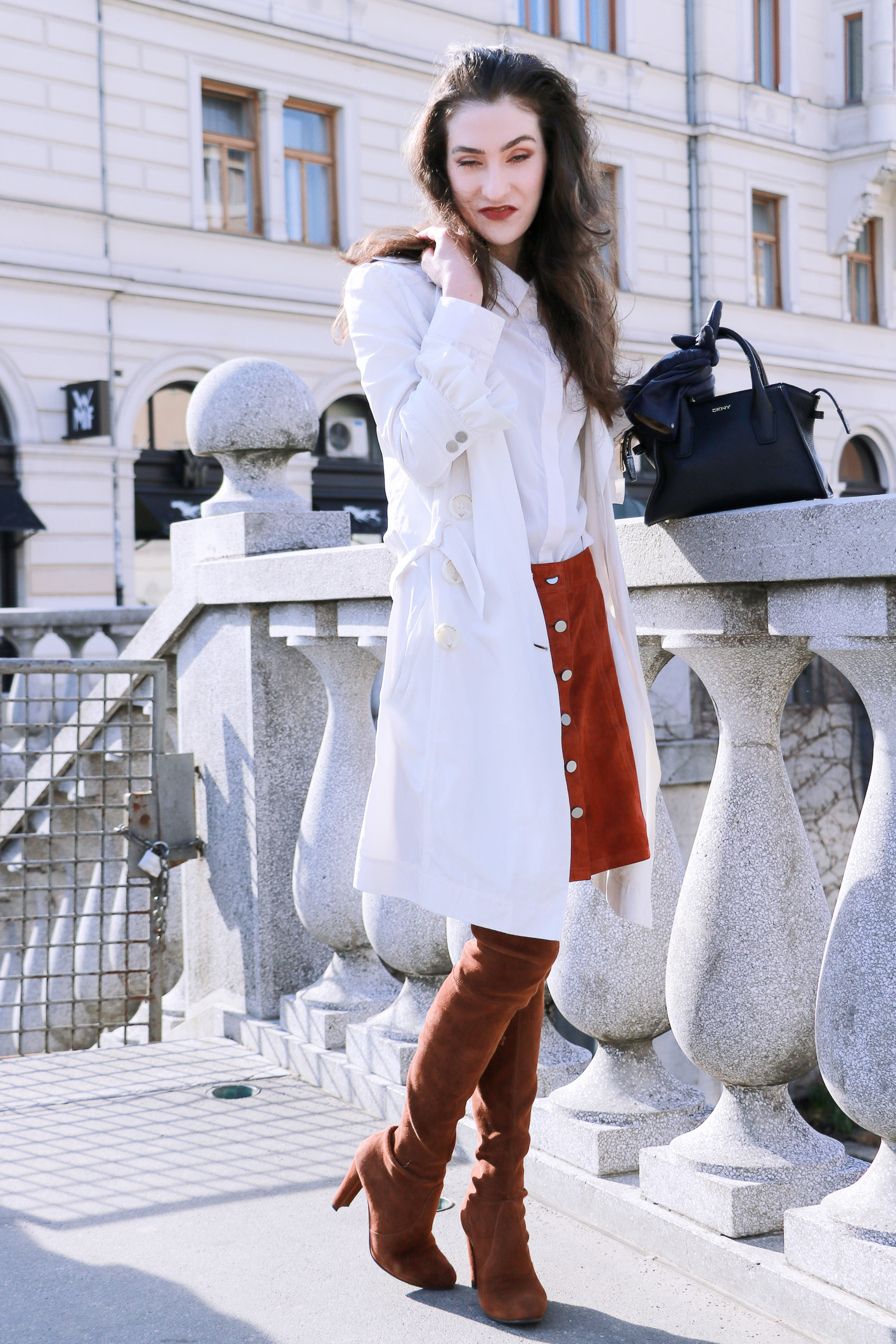 Fashion blogger Veronika Lipar of Brunette From Wall Street sharing how to style a long thin trench coat this spring