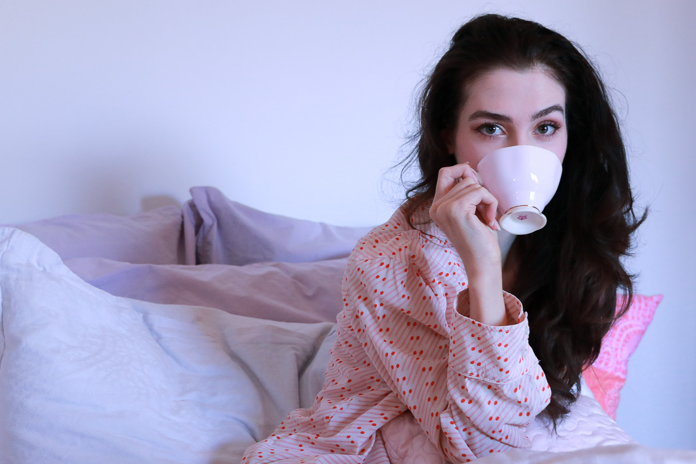 Fashion blogger Veronika Lipar of Brunette From Wall Street drinking coffee in bed