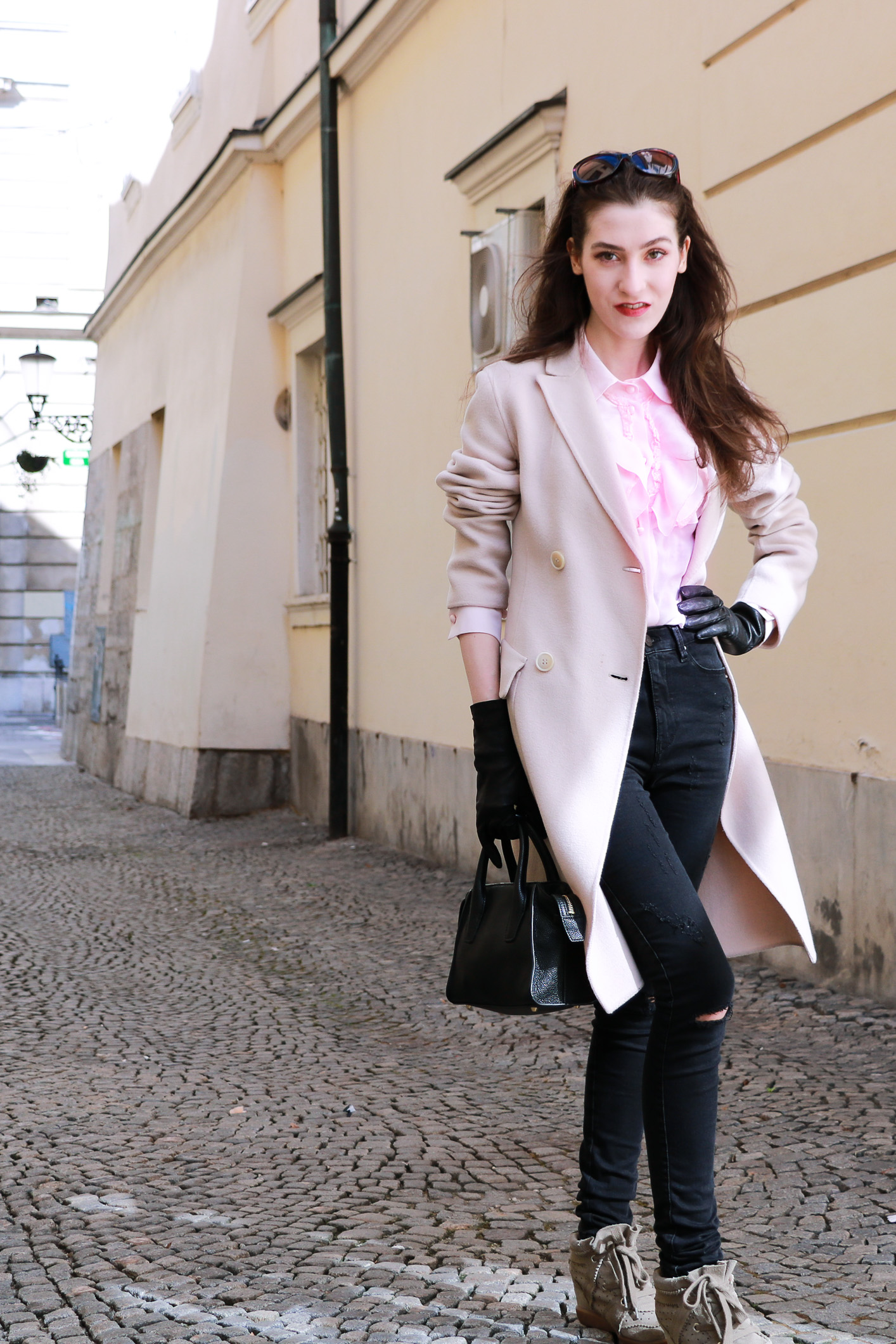 Fashion blogger Veronika Lipar of Brunette From Wall Street sharing her casual spring fashionable outfit and wedge sneakers
