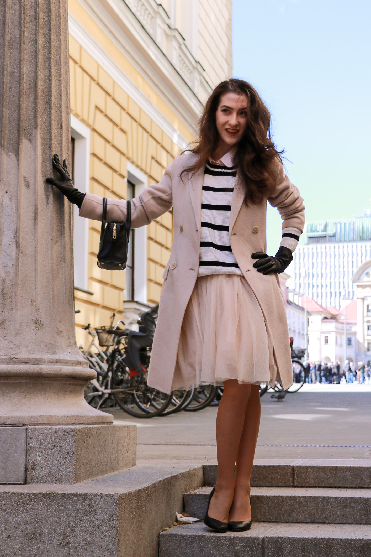 Fashion blogger Veronika Lipar of Brunette From Wall Street wearing zara dress and striped top with pink coat