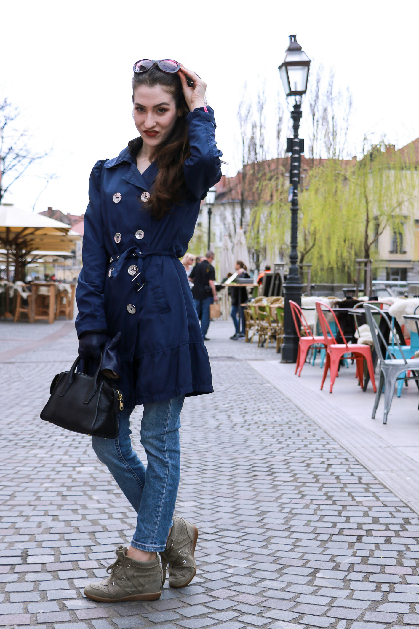 Fashion blogger Veronika Lipar of Brunette From Wall Street sharing her chic casual blue Friday outfit