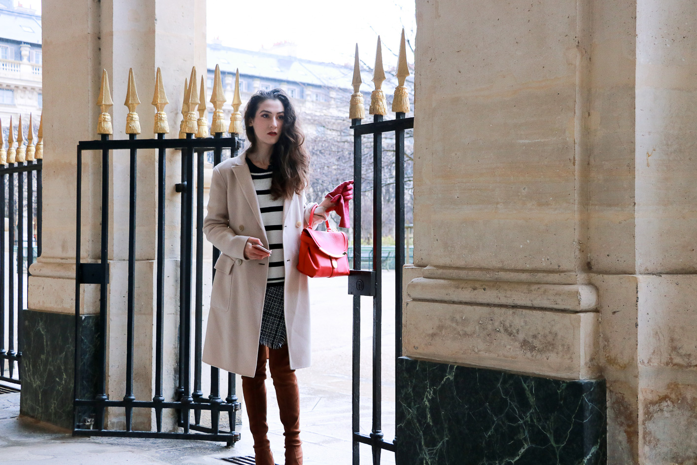 Fashion blogger Veronika Lipar of Brunette From Wall Street on how to wear striped crop sweater like a French Fashionista