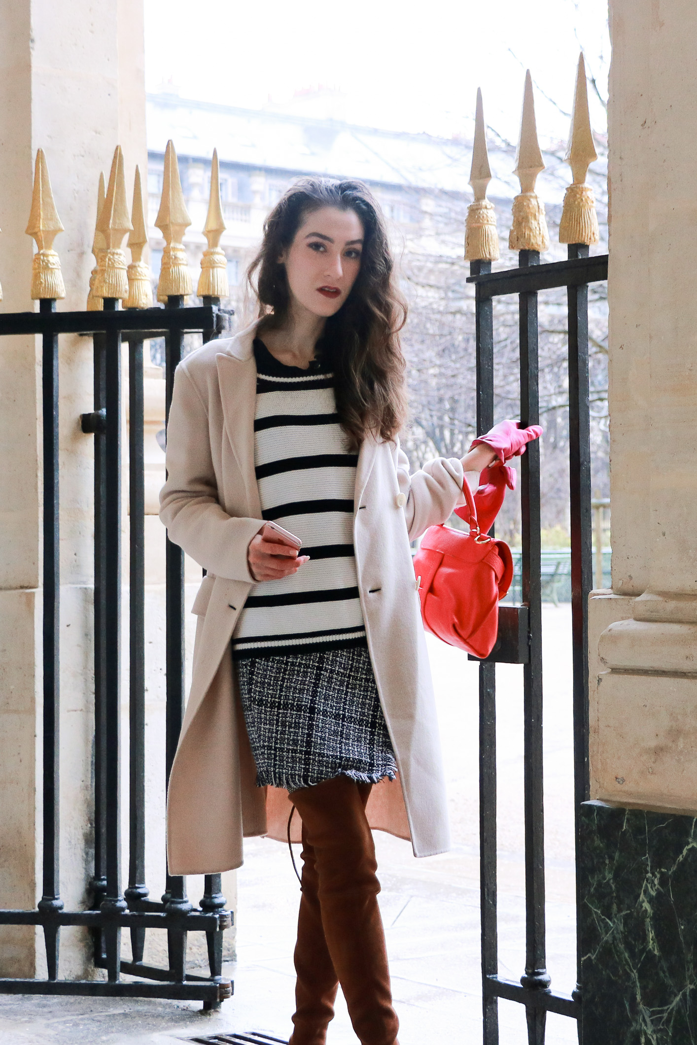 Fashion blogger Veronika Lipar of Brunette From Wall Street on how to wear striped sweater like a French Fashionista