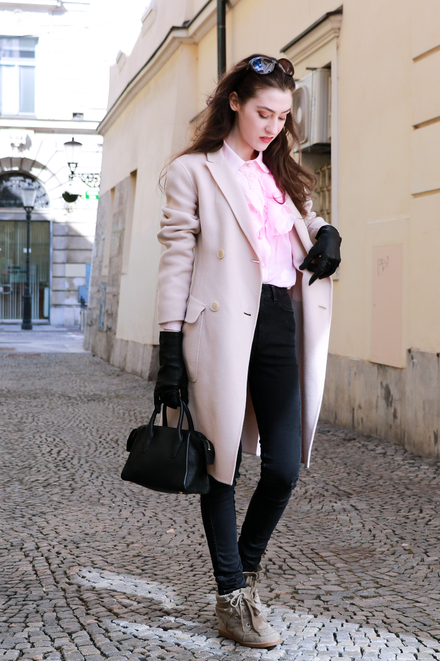 Fashion blogger Veronika Lipar of Brunette From Wall Street on how to style pink clothes and Isabel Marant Bobby Sneakers this spring