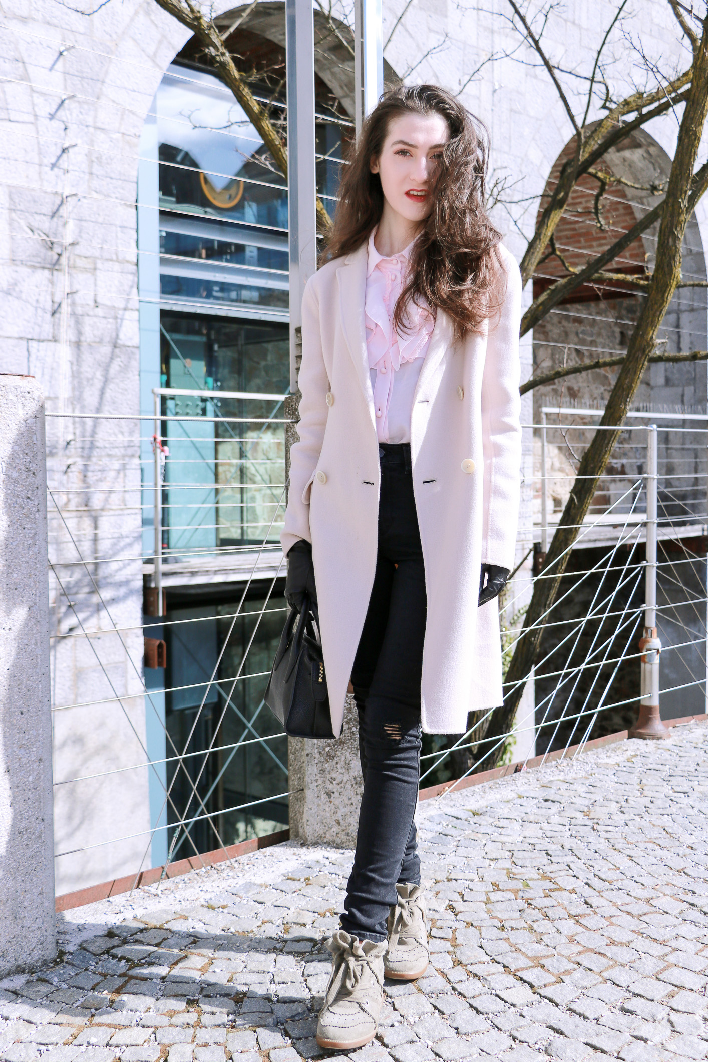 Fashion blogger Veronika Lipar of Brunette From Wall Street on how to wear pink colour and black ripped jeans this spring