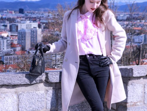 Fashion blogger Veronika Lipar of Brunette From Wall Street on how to wear pink color and black ripped jeans this spring