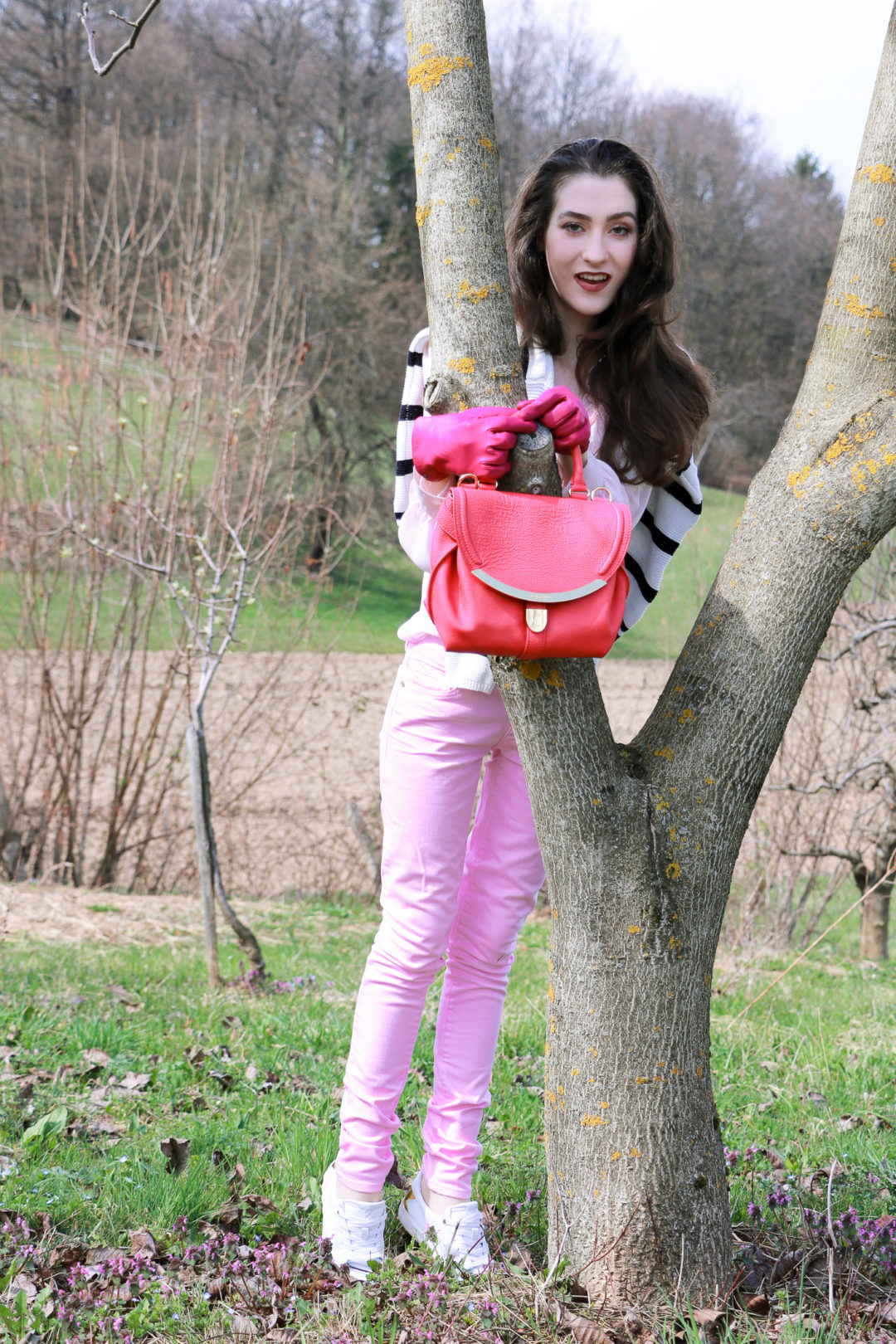 Fashion blogger Veronika Lipar of Brunette From Wall Street sharing her pink Wednesday Look