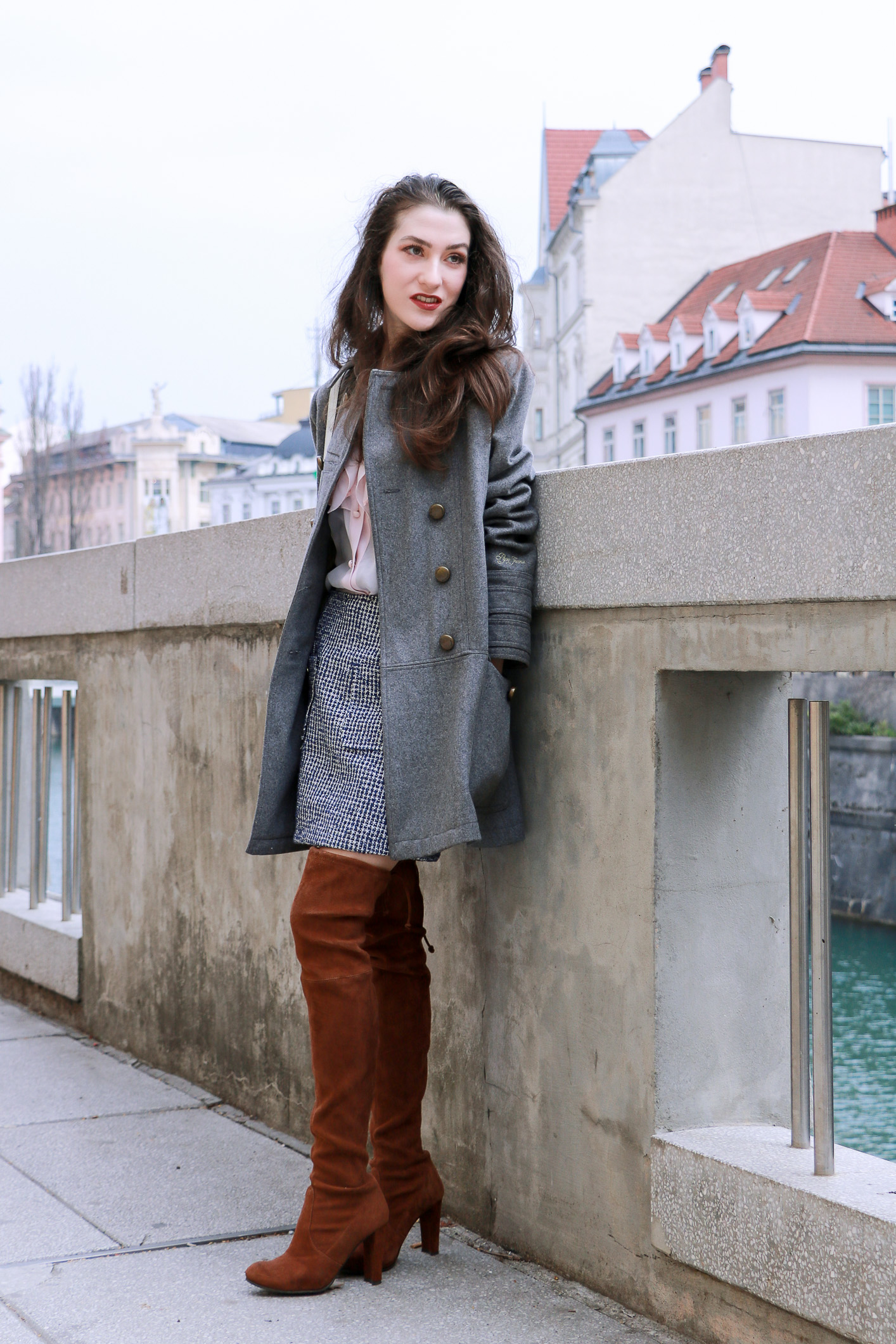 Fashion blogger Veronika Lipar of Brunette From Wall Street sharing how to wear over the knee boots this spring