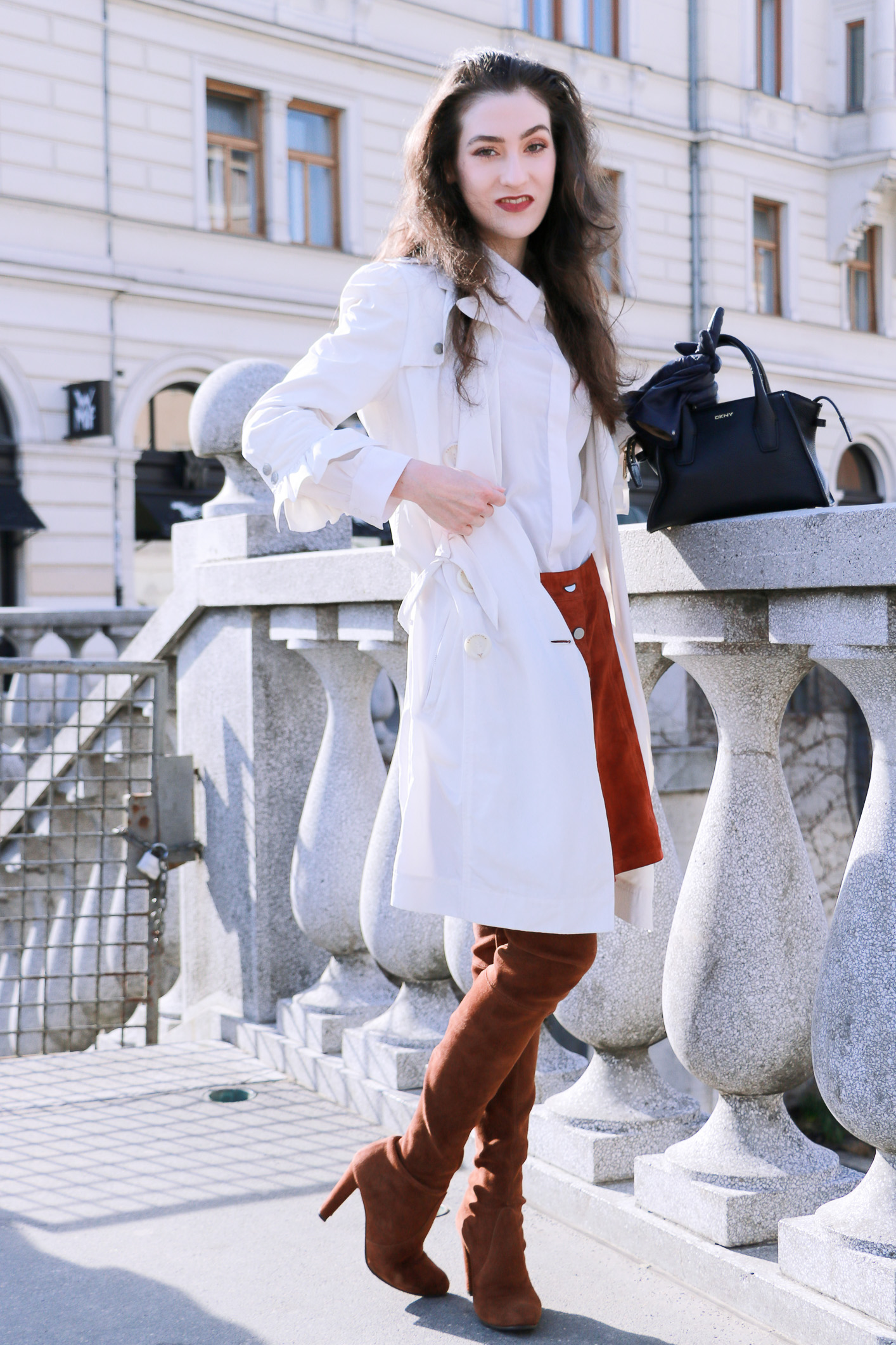Fashion blogger Veronika Lipar of Brunette From Wall Street sharing how to style a long thin trench robe this spring