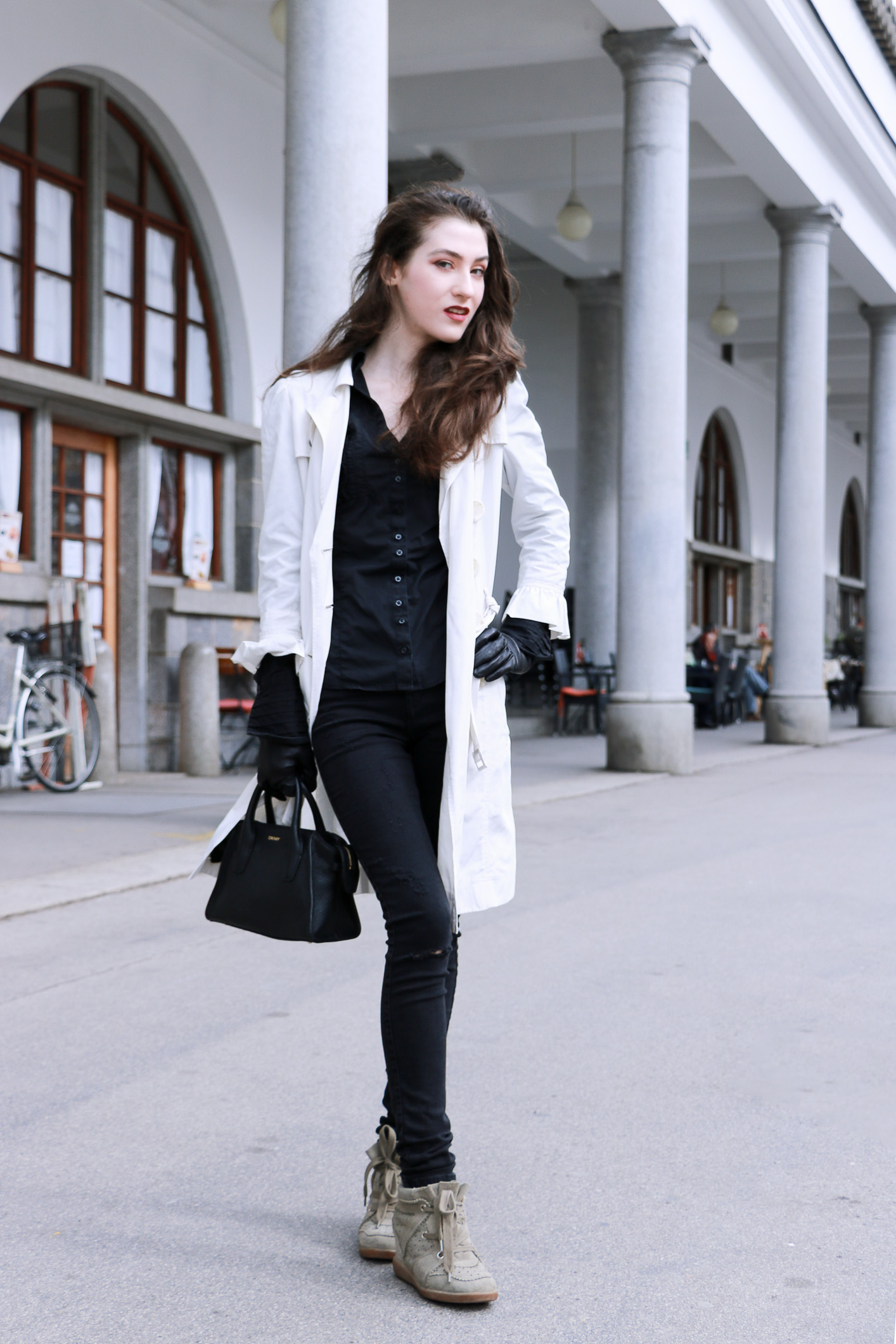 Fashion blogger Veronika Lipar of Brunette From Wall Street sharing her chic black and white ruffled spring look