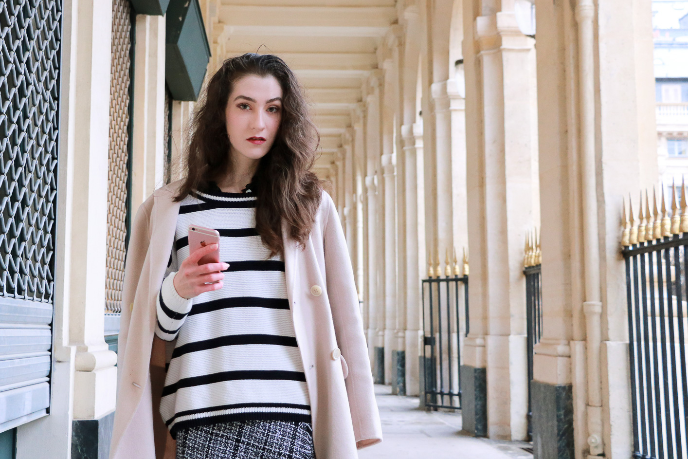 Fashion blogger Veronika Lipar of Brunette From Wall Street on how to wear striped top like a French Fashionista