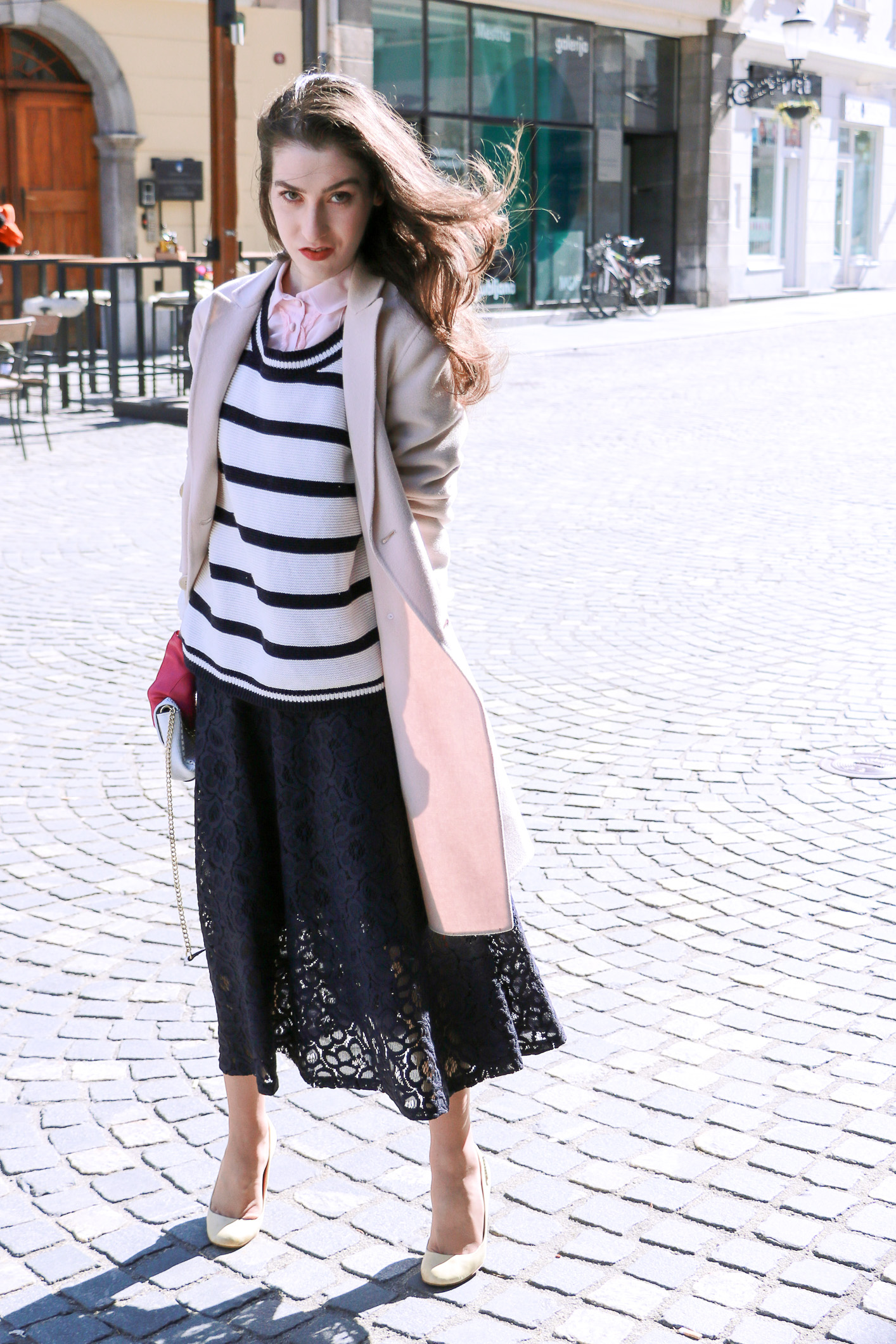 Fashion blogger Veronika Lipar of Brunette From Wall Street on how to wear striped top over the midi skirt as seen on the catwalks this season