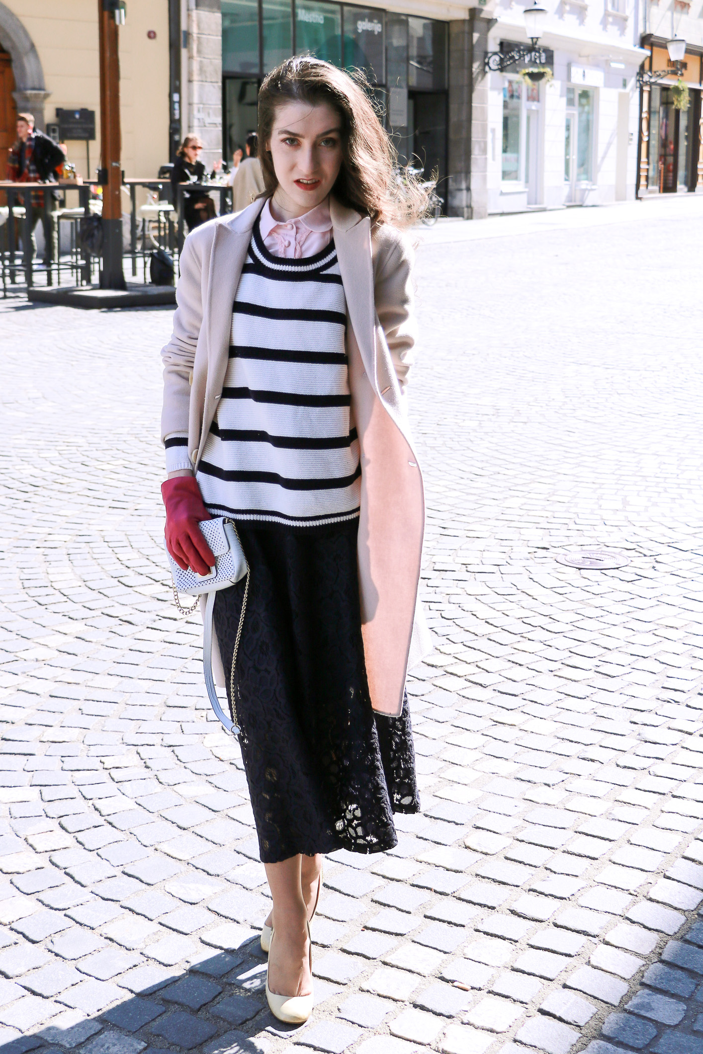 Fashion blogger Veronika Lipar of Brunette From Wall Street on how to style striped top over the midi skirt as seen on the catwalks this season